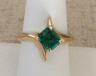 Vintage 14 K Gold Lady's Emerald Ring with One Square Cut Emerald Weighing 1.25 Carats.