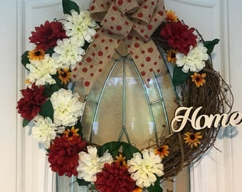 Grapevine Wreath, Burlap Bow, Red Carnations, White Carnations, Sunflowers, Polka dots, Home!