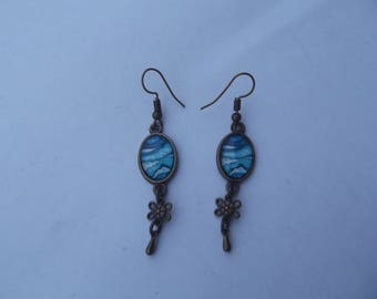 "Dangling earrings with hooks bronze color and small oval glass cabochon pattern ""paint splash"" white and turquoise"