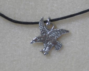 American Eagle silver charm on a black, 16 inch cord necklace.  Men's necklace with an eagle.