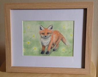 Framed watercolour painting of a red fox in a meadow of yellow flowers