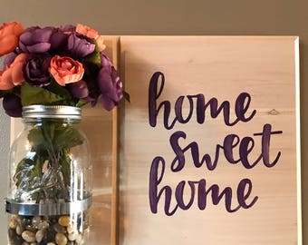 "Mason jar ""home sweet home"" with flowers"