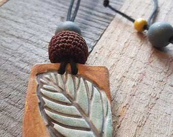 Ceramic Leaf pedant, earthy, up cycled crochet bead and grey rubber bead. Handmade.