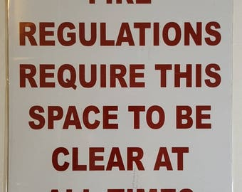 Fire Regulation Require This Space To Be Clear At All Times , 18 high x 12 wide, RED on White