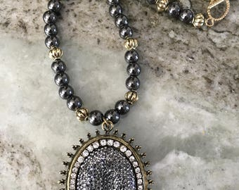 Hematite and Gold Metal Necklace with Crystal and Metal Pendant