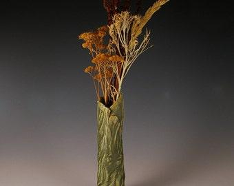 Rustic bud vase in green.
