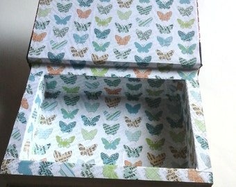 booksafe made from readers digest condensed book  and lined with pretty butterfly paper.