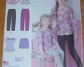 Simplicity 1334 Size 7-14 new and uncut