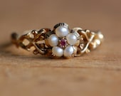 Antique Georgian 15 CT pearl and ruby posey ring with compartment