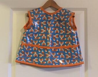 Sleeveless Waterproof Toddler Art Smock Waterproof Toddler Bib in Blue with Orange Foxes