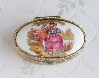 Rococo Lovers - Vintage pill Box - Oval Golden toned with Porcelain Lid