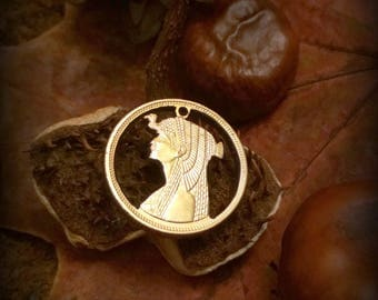 Cleopatra's head. Cleo Iconic beauty symbol. Coin jewelry necklace pendant charm