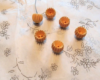 set of six yellow gold vintage bakelite buttons