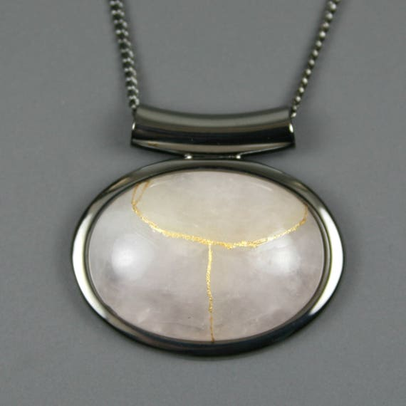 Kintsugi (kintsukuroi) rose quartz stone cabochon with gold repair in a gunmetal plated setting on gunmetal chain - OOAK