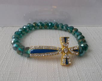 Blue/Green Crystal Stretch Bracelet with a Gold, Blue and Clear Rhinestone Cross Charm
