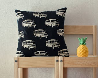 Black pillow cover with large buses