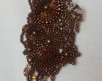 Beaded brooch with copper beads and satin beads
