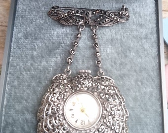 Vintage sterling silver and marcasite suspended watch /brooch