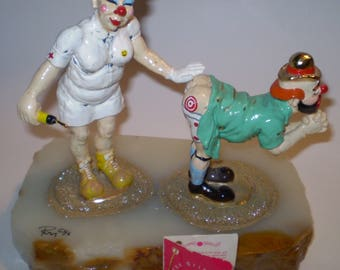 Ron Lee Figurine Nurse and Clown Getting a Shot in his Buttocks with pants down called Get The Point Ron Lee
