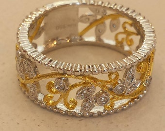 18 K white and yellow gold diamond band