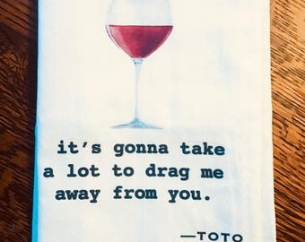 Funny tea towel: it's gonna take a lot to drag me away from you.  Toto
