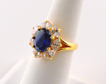 Size 6 Gold Tone 4ct Oval Man Made Sapphire Ring With 8 - .25ct Oval Cubic Zirconias