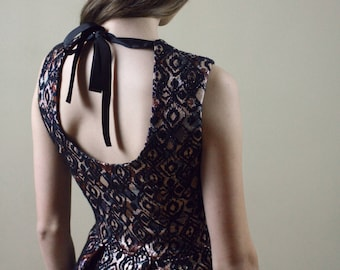 Designer brocade flare party dress with open back and ribbon bow