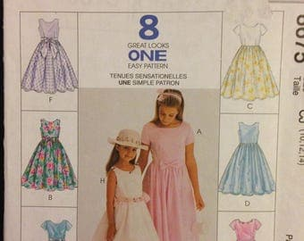 McCalls 8675 Girls Party Dress in 50s Retro Style with Waist Darts, Full Skirt and Round Neck - Size 10 12 14