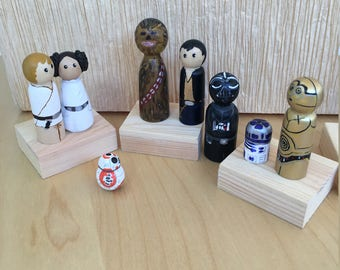 Star Wars wooden characters painted by hand to play, to decorate the bedroom or as toys for birthday cake.  Peg Dolls.