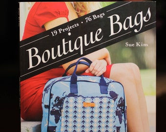Boutique Bags:  book contains instructions for 19 projects and 76 bags.