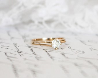 4.50mm Charles & Colvard Moissanite in Unique (Handmade?) 9k Yellow Gold Solitaire Ring (with optional Fine Gold Band)