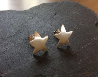 Silver star stud earrings, contemporary, 925 sterling silver, domed, brushed finish.