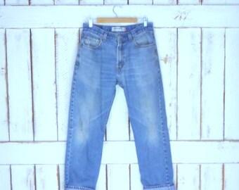 Levis 505 zipper fly denim jeans/regular fit straight leg blue jeans/faded/distressed/destroyed vintage Levi Strauss jeans