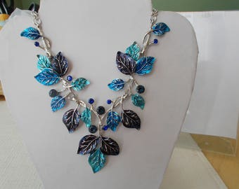 Pendant Necklace with Blue, Turquoise and Black Leaves and Blue and Black Rhinestones on a Silver Tone Chain