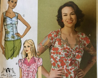 Butterick B6217. Sizes 4-6-8-10-12. Misses blouse -- Easy to sew, loose fitting with front button closure. Pattern is new and uncut.