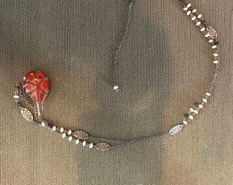 Flower embellished glass necklace