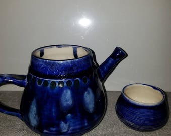Blue teapot with teacup lid