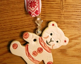 Teddy Bear Handmade Pottery Ornament, with hand painted glazes. Sent to you in a lovely gossamer bag ready to give as a gift.