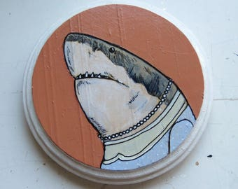 Small round painting of Great White Shark in a dress