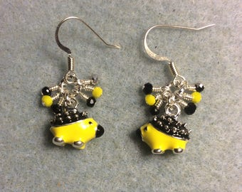 Black, yellow, and silver enamel porcupine charm earrings adorned with tiny dangling black, yellow, and silver Chinese crystal beads.
