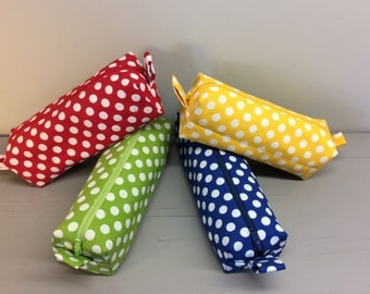 Pencil case with polka dots.