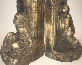 A pair of old bookends Esther hunt? No signature found