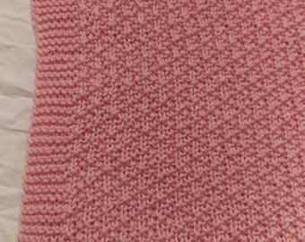 Pink hand knitted baby blanket