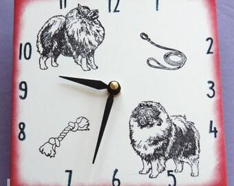 "Ceramic tile Keeshond dog clock, 6"" square, red border"