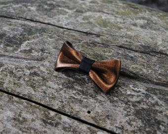 Hair bow in black leather and bronze