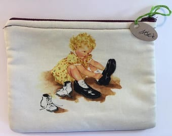 Vintage clutch printed little girl and black print with stars.