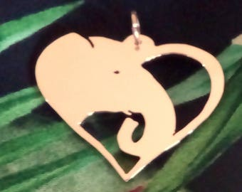A love heart with Elephant in copper