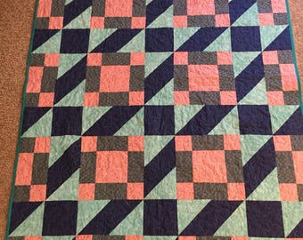 Beautiful Quilt made with the wagon tracks pattern.