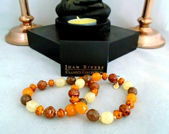 NWT Joan Rivers Set of Two New Bracelets in Gold and other Natural Colors Czech Glass Beads in Black Pouch with Romance Card.