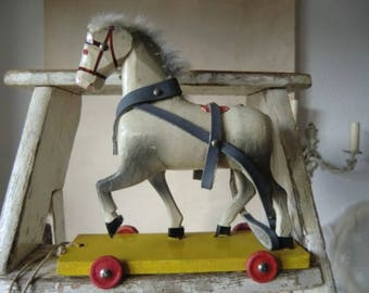 Vintage wooden horse pulling horse on wheels old wooden toys